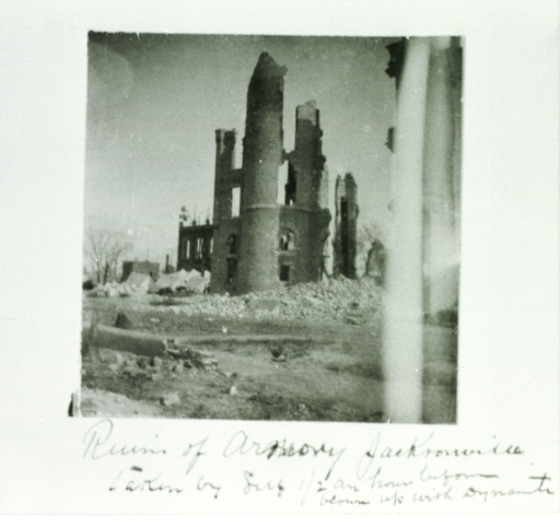 <p>Exterior view of remains of armory building shortly before being completely destroyed.</p>