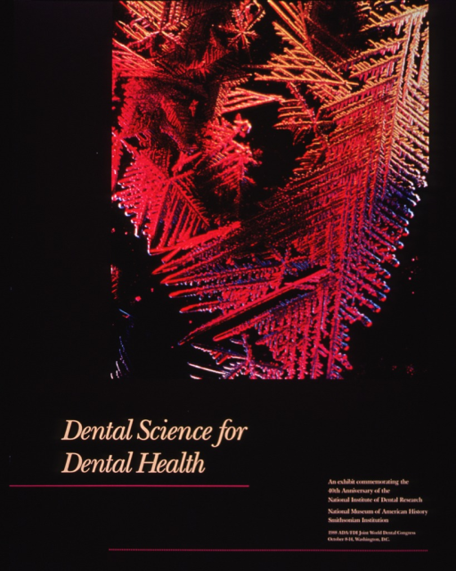 <p>Gray poster with tan lettering and fuchsia accents.  Top of poster has photo image of a  fuchsia, gold, and blue fluoride crystal on a black background.  Poster includes dates and location for 1988 ADA/FDI Joint World Dental Congress in lower right corner.</p>