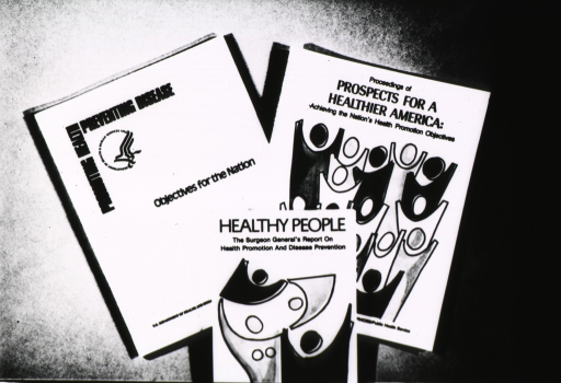 <p>The covers of: Promoting Health, Preventing Disease; Proceedings of Prospects for a Healthier America: Achieving the Nation's Health Promotion Objectives; and Healthy People: The Surgeon General's Report on Health Promotion and Disease Prevention.</p>