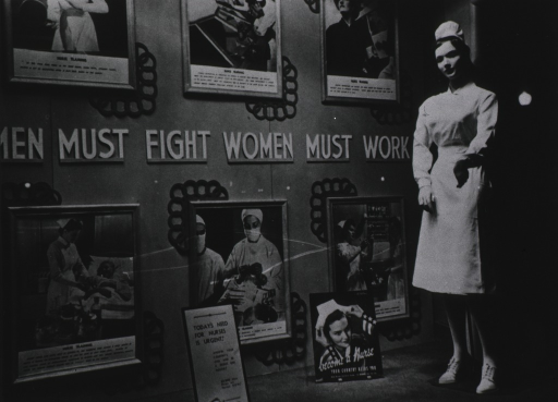 <p>Around the banner &quot;Men Must Fight Women Must Work&quot; are illustrations depicting the duties of nurses; a manikin wearing a nurses uniform stands to the right.</p>