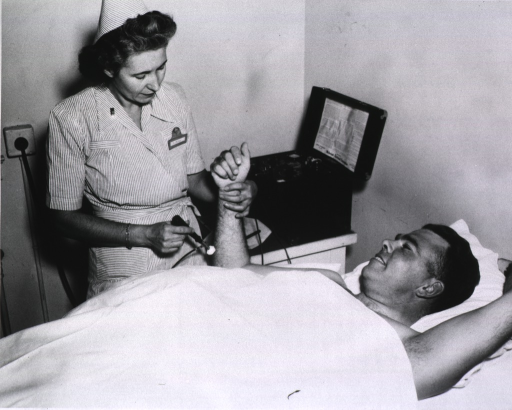 <p>Nurse giving electrical muscle test to soldier.</p>