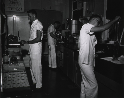 <p>Corpsmen preparing prescriptions in the hospital pharmacy.</p>