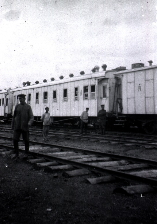 <p>Four soldiers(?) on the railroad tracks near the Tzaravitch Red Cross train.</p>