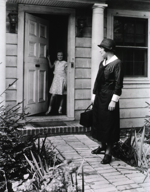 <p>Showing a nurse on the walkway leading to the front door and a young girl standing at the open door.</p>