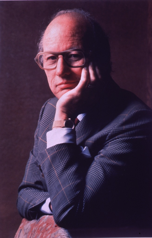 <p>Head and shoulders, right pose; wearing glasses; left hand under chin and on left cheek.</p>