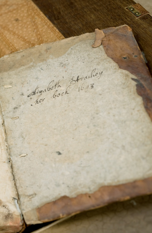 <p>The inside cover of Elizabeth Strachey's recipe book which bears her signature and a date.</p>