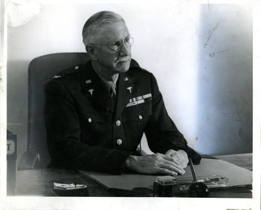 <p>Medical Doctor and Army Medical Corps Colonel Harold Wellington Jones seated at a desk.</p>