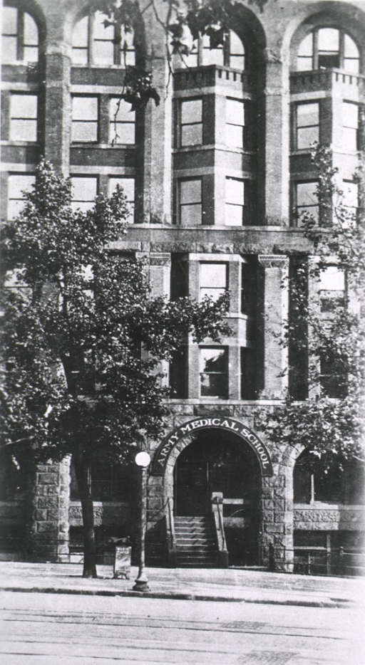 <p>Exterior view of a building with an arch that reads: Army  Medical School.</p>