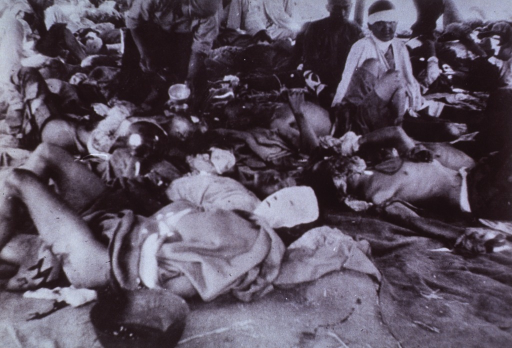 <p>Second Hiroshima Military Hospital.  Appalling conditions of crowding prevail.  A nurse is ministering to the injured.  Mask dressings have been applied to burned faces.  There is no evidence of intravenous fluid therapy.</p>