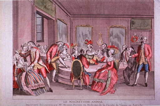 <p>Interior view: Drawing room scene with many people sitting and standing around a large table; a man on a crutch has an iron band wrapped around his ankle; others in the group are holding bands similarly; to the left, a man has hypnotized a woman.</p>
