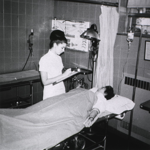 <p>Patient in emergency room with clerk taking information.</p>