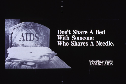 <p>Predominantly black poster with black and white lettering.  Title on right side of poster.  Visual image, on left side, is a reproduction of a b&amp;w photo of a bed.  The bed's headboard is a tombstone labeled &quot;AIDS&quot; with two sets of birth and death dates.  Publisher information in lower right corner.</p>
