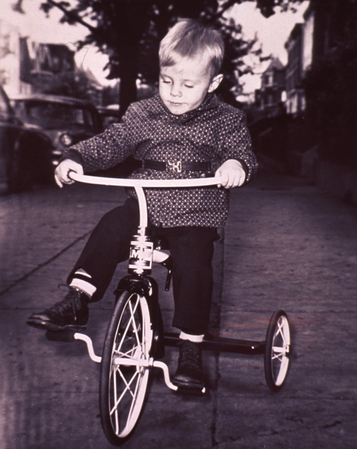 <p>A child on a tricycle.</p>