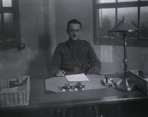 <p>Half-length, seated at desk, full face, wearing uniform (Captain).</p>