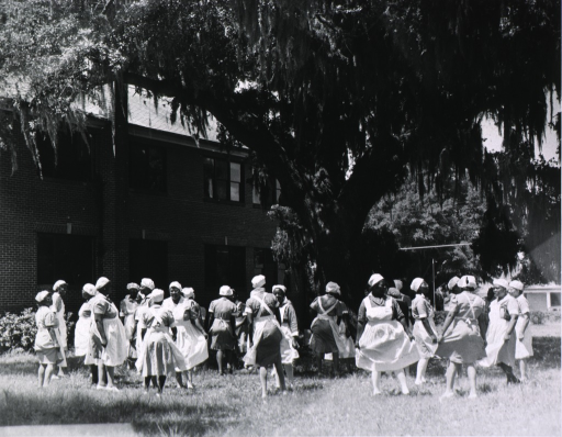 <p>View of African American nurse midwives enjoying the outside.</p>