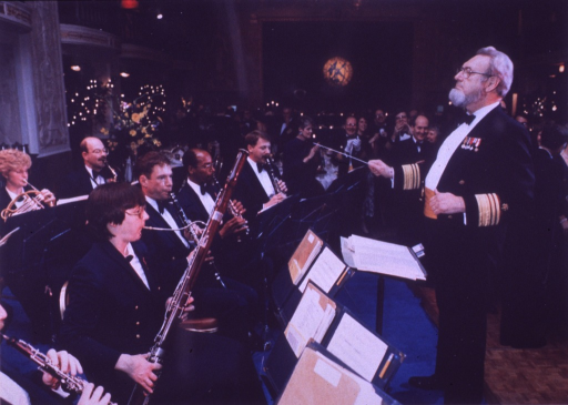 <p>C. Everett Koop, wearing uniform, conducts the Coast Guard band during the gala to inaugurate the centennial year of the USPHS Commissioned Corps.</p>
