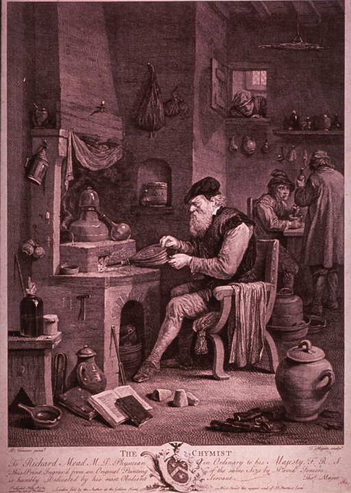 <p>Interior scene: an old man sits before a furnace working a bellows; books and containers lay about on the floor; two men work at a table in the background, a man peers through a window above them.</p>