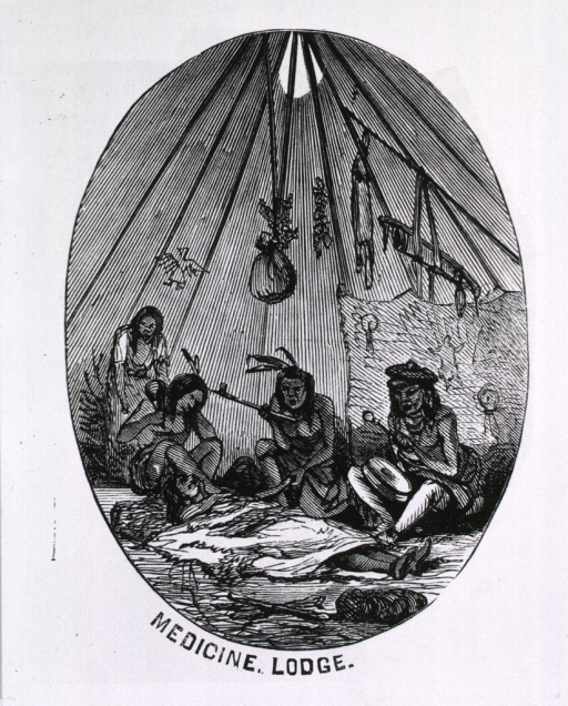 <p>Medicine Lodge [interior of tent with patient and medicine men seated around].</p>