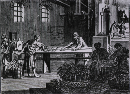 <p>Workers at a long bench are rolling and spinning tobacco leaves; others sitting nearby are binding together clusters of leaves taken from large baskets.</p>