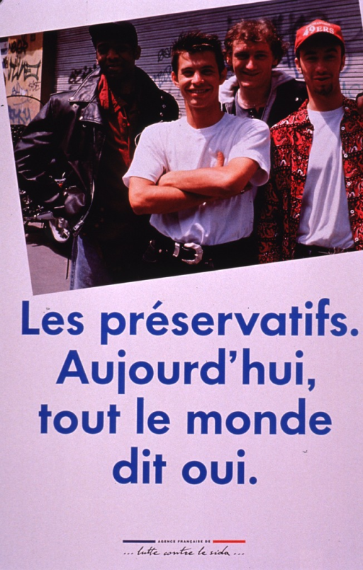 <p>White poster with blue lettering. The upper half consists of a photo reproduction of four young men from the waist up, all dressed in T-shirts, and jeans. The publishing information is at the bottom of the poster in black print.</p>