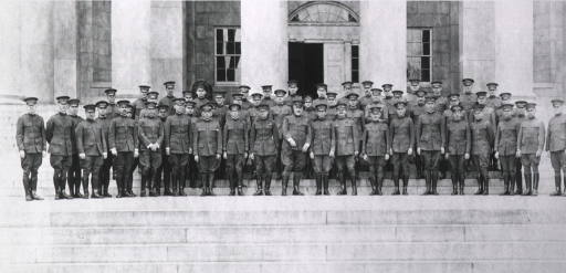 <p>Exterior view of men in uniform standing on the steps of the Army Medical School.</p>