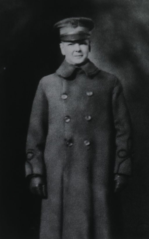 <p>Standing, three quarter length, front.  In top coat and cap.</p>