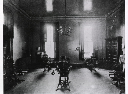 <p>The dental infirmary, showing cabinet, dental chairs, etc.</p>