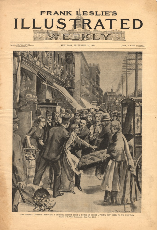 <p>A woman is helped to an ambulance by a group of people.  A crowd has gathered behid them on the sidewalk.</p>