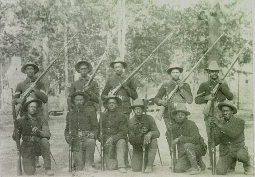 <p>Two rows of African American soldiers holding rifles.</p>