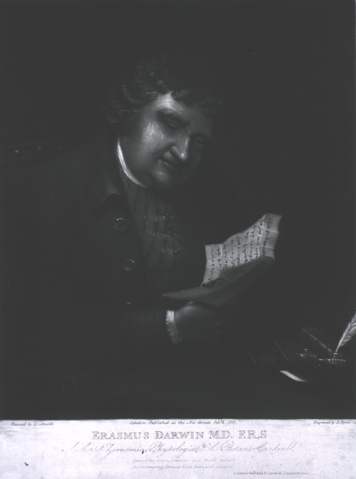 <p>Seated, reading, face forward, showing books and quill.</p>