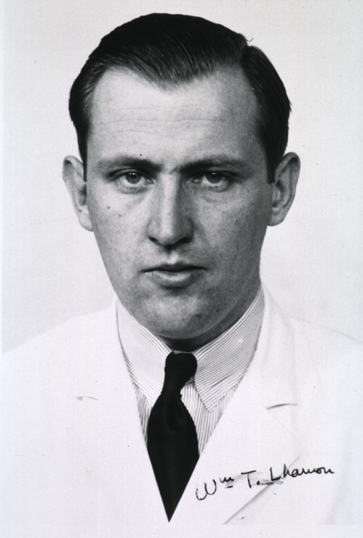 <p>Head and shoulders, full face; wearing white coat.</p>
