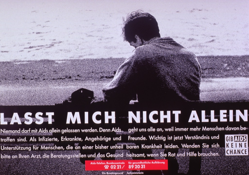 <p>Predominantly black and white poster with pink highlights.  Visual image is a b&amp;w photo reproduction featuring a man sitting alone on a bench.  Title superimposed on image near center of poster.  Caption below title addresses the importance of not isolating people with AIDS, but rather offering understanding.  It encourages seeking information from doctors and other health authorities.  Note text in lower right corner urges giving AIDS no chance.  Publisher information at bottom of poster.</p>