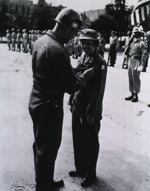 <p>Full length, receiving oakleaf cluster from Gen. Taylor.</p>