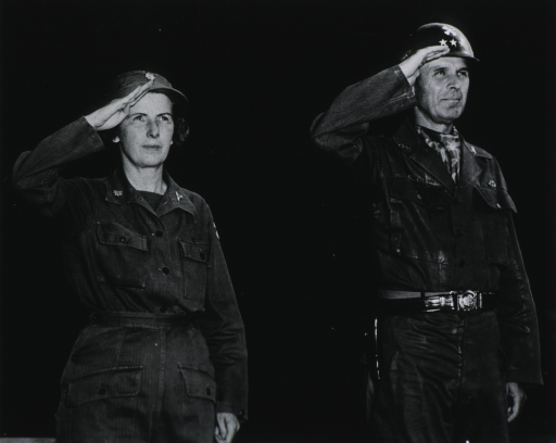 <p>Three-quarter length, wearing fatigues, standing at attention with Gen. Taylor.</p>