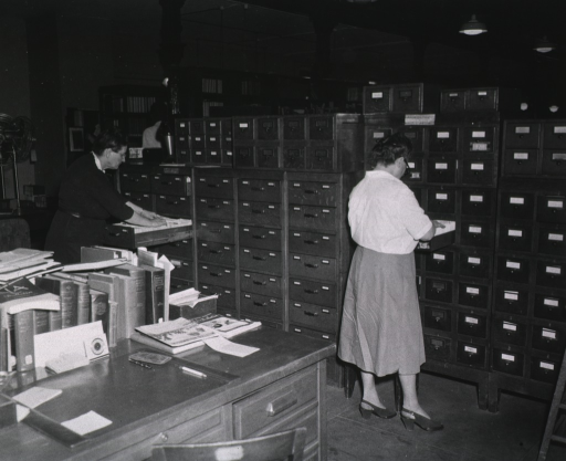 <p>Interior view: Stacks are behind, and desks are in front of, the author index in the Index Catalogue Division.</p>
