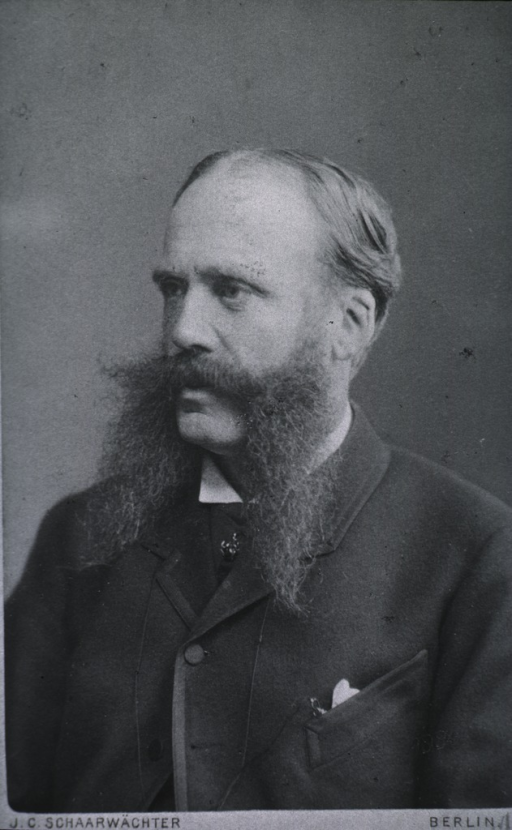<p>Head and shoulders, left pose.  Wearing long side whiskers.</p>