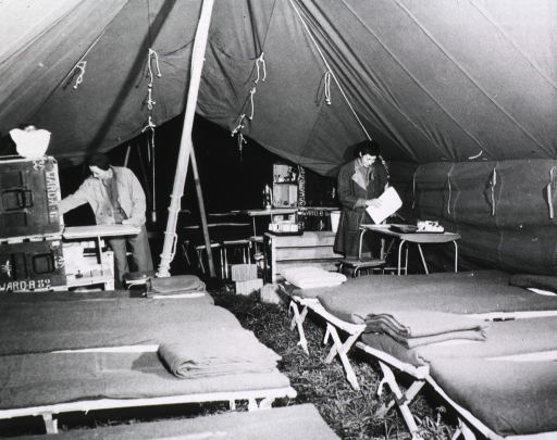<p>Lieutenants L.L. Cloyd and Angela J. Brushti check medical supplies in an unoccupied ward tent at the 8th Evacuation Hospital near Capua, Italy.</p>
