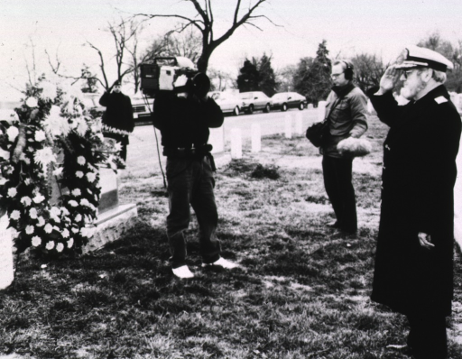 <p>C. Everett Koop, wearing uniform coat and cap, salutes the grave of Luther Terry in Arlington Cemetery.</p>
