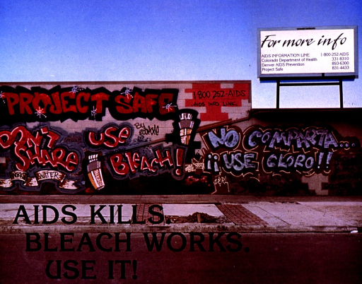 <p>Multicolor poster.  Visual image is a color photo reproduction featuring a brick wall covered by a graffiti mural.  The mural depicts containers of bleach and the note text, along with phone numbers for health and AIDS organizations.  A billboard in the background reiterates the phone numbers.  Title superimposed on lower left corner of poster.</p>