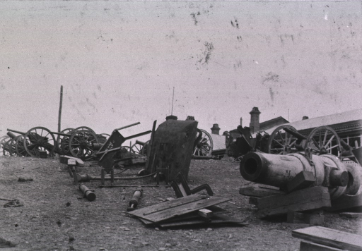 <p>A view of several canons, some disassembled, at a Russian hospital in Port Arthur.</p>
