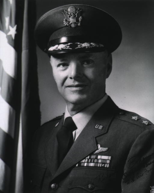 <p>Head and shoulders, full face; wearing U.S. Air Force uniform and cap (two star general).  Autographed.</p>