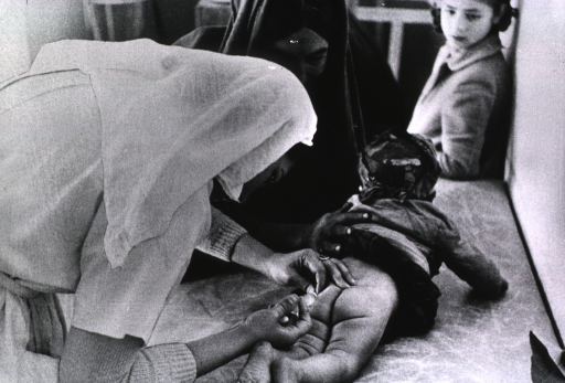 <p>A small child is receiving an injection of vaccine against diphtheria, whooping cough, and tetanus.</p>