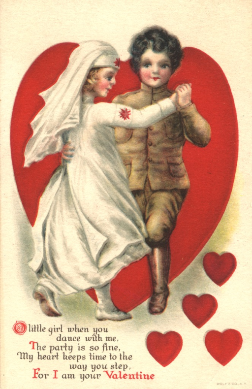 <p>Postcard featuring a color illustration of two children dancing. The girl is dressed as a nurse and the boy is dressed as a soldier. A large heart surrounds them and four little hearts are drawn on the bottom right of the postcard.</p>