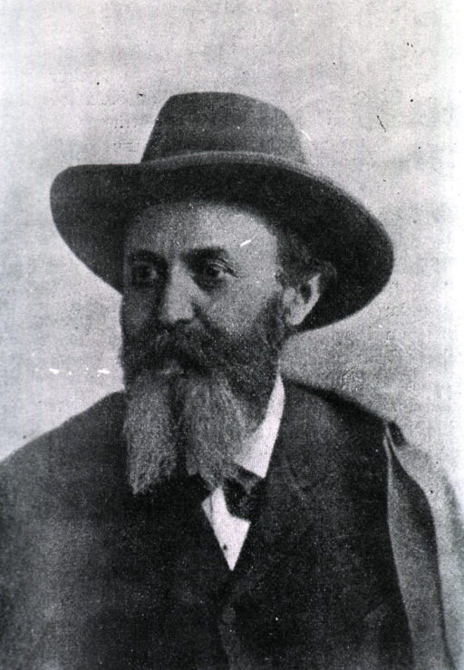 <p>Head and shoulders, left face, wearing felt hat.</p>