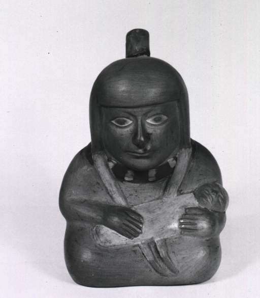 <p>Sculpture:  Spouted urn with seated woman holding infant in her arms.</p>