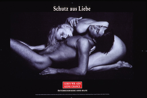<p>Predominantly black poster with white lettering and red highlights.  Title at top of poster.  Visual image is a black and white photo reproduction showing a naked, male-female couple.  The man lies on his back, with his head resting in the woman's lap.  The woman sits on her legs and drapes her head over the man's shoulder.  Note and publisher information below photo.</p>