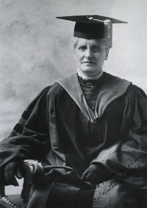<p>Seated, wearing cap and gown, full face.</p>