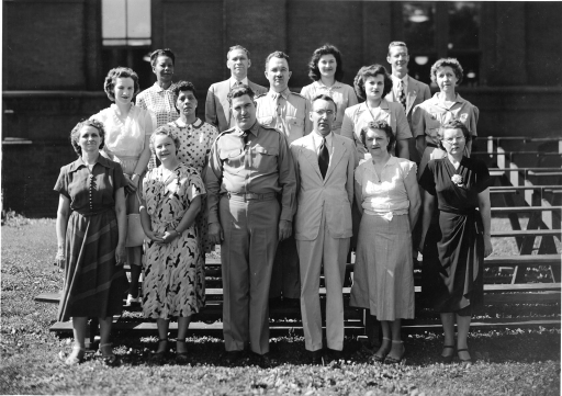 <p>Army Medical Library Offices of the Director and Librarian. Front Row: Miss Corinne Tucker, Mrs. Aldine Mudd, Colonel Joseph H. McNinch, MC (Director), Mr. Scott Adams (Acting Librarian), Mrs. Ethel M. Chase, Mrs. Alice Luethy. 2nd Row: Mrs. Martha Dietrich, Mrs. Sarah L. Jenifer, Major Frank B. Rogers, MC, (Assistant Director) Miss Dorothy Joy Simken, Miss Mary J. Henke. Back Row: Mrs. Lee Dean, Mr. Joseph L. Tucker, Mrs. Mary M. Koehler, Mr. Sam W. Roberts.</p>