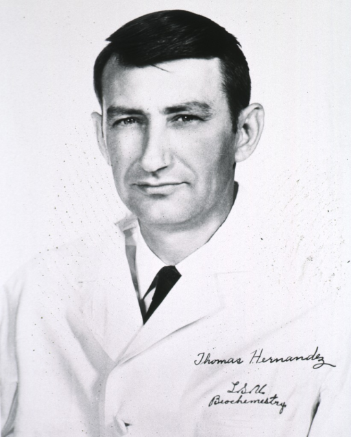 <p>Head and shoulders, left pose, full face, wearing white coat.</p>