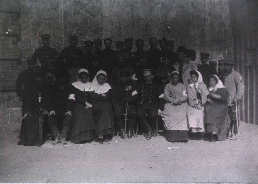 <p>A potrait of clergy and Red Cross personnel, Russian hospital, Port Arthur.</p>